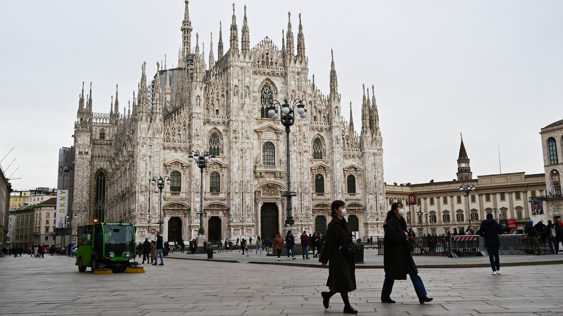 A photo shows people walking on an almost empty Piazza del Duomo in central Milan, on February 27, 2020 amid fears over the spread of the novel Coronavirus. (AFP)