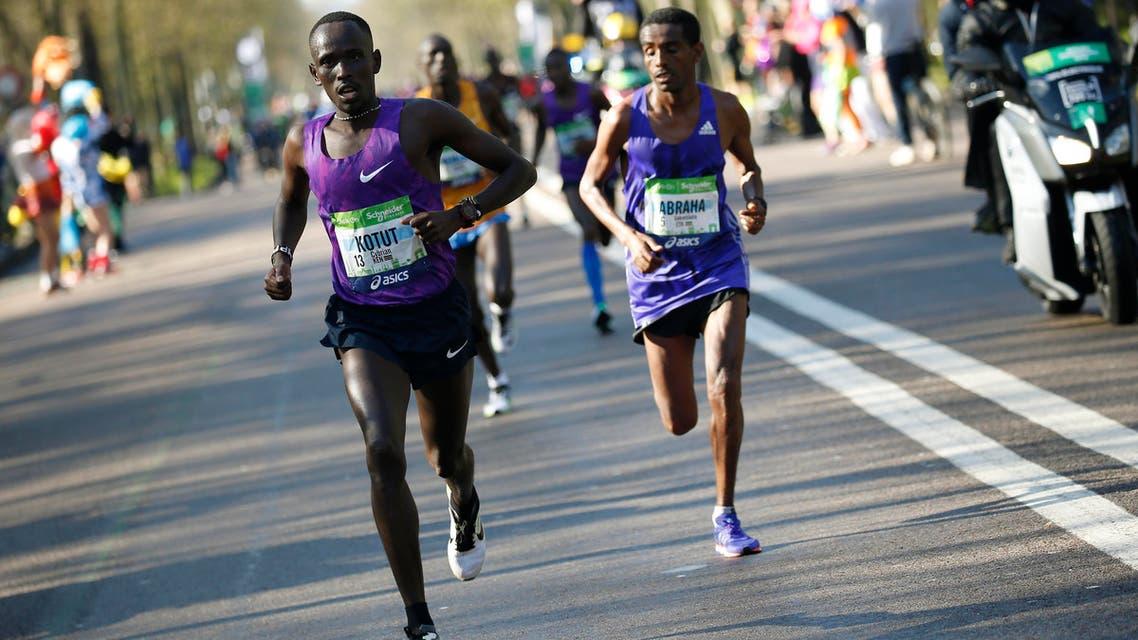 File photo of the Kenyan Cyprian Kotut (left) runs during the 40th Paris Marathon, on April 3, 2016 in Paris. (AFP)