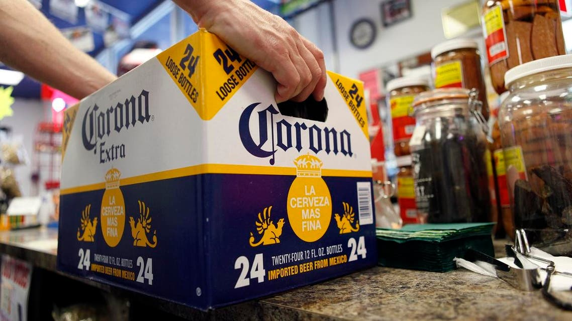 In this April 1, 2010, file photo, a customer places a case of Corona Extra on the checkout counter for purchase at Susquehanna Beer and Soda in Marysville, Pa. (AP)