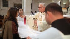 Catholic churches in Holy Land to give communion by hand due to coronavirus