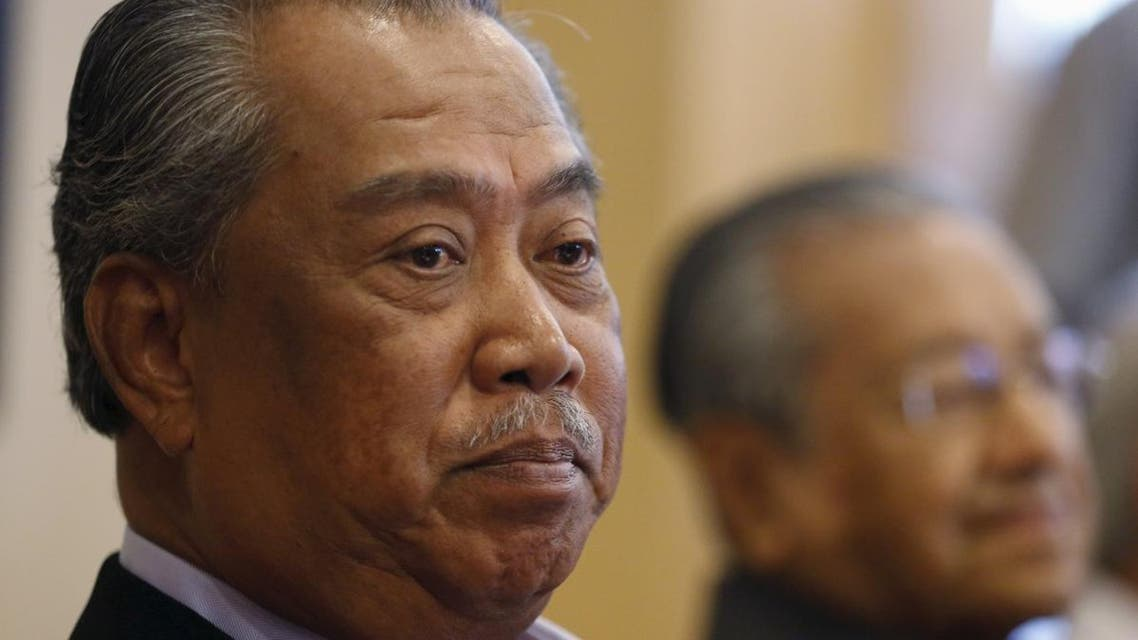 UMNO's Deputy President Muhyiddin Yassin (L) and former prime minister Mahathir Mohamad give a news conference in Putrajaya, Malaysia. (Reuters)