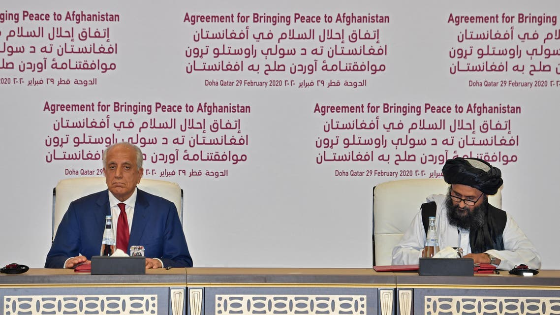 S Special Representative for Afghanistan Reconciliation Zalmay Khalilzad and Taliban co-founder Mullah Abdul Ghani Baradar sign a peace agreement during a ceremony in the Qatari capital Doha on February 29, 2020. (AFP)