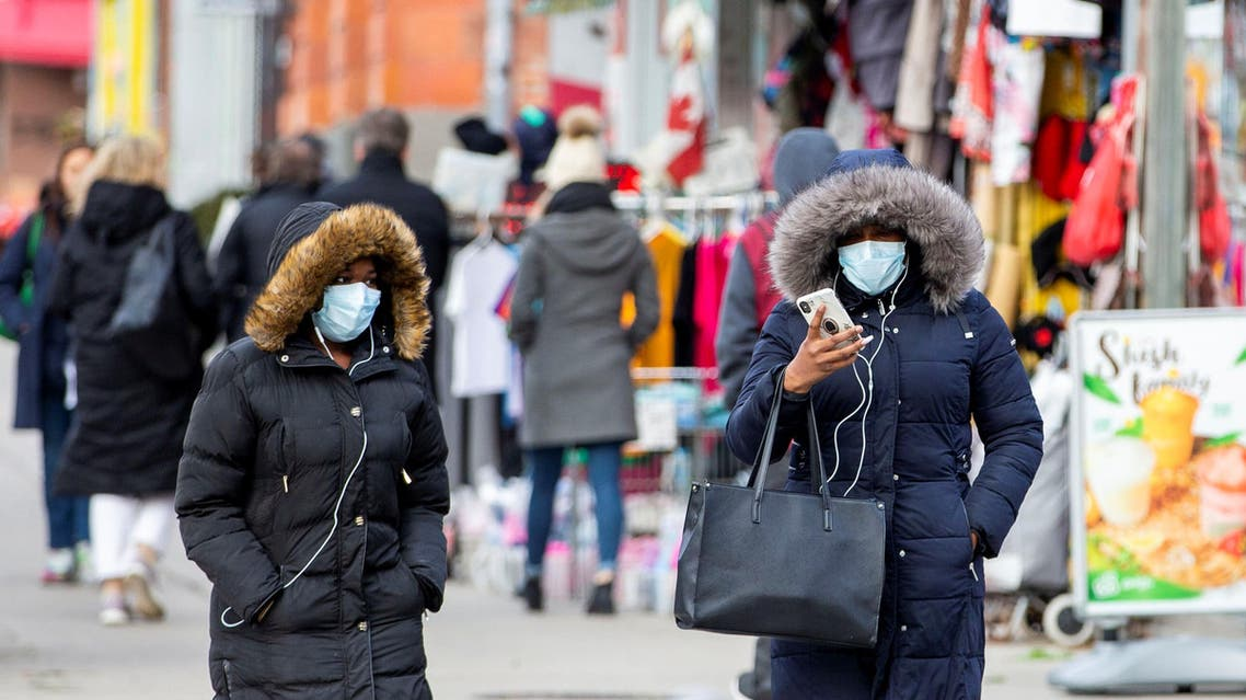 Pedestrians walk in the Chinatown district of downtown Toronto, Ontario, after 3 patients with novel coronavirus were reported in Canada January 28, 2020. REUTERS