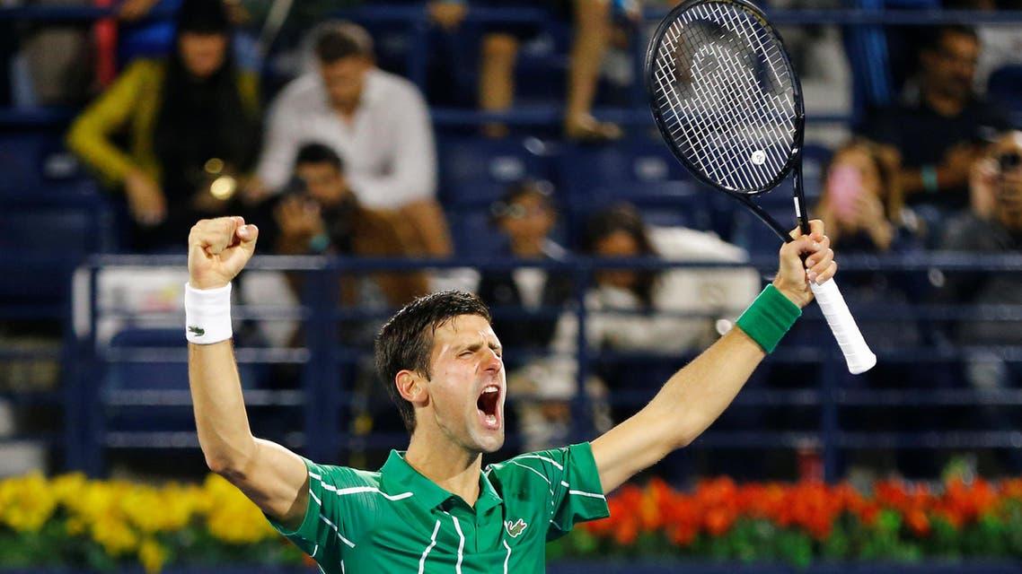 Serbia's Novak Djokovic celebrates winning his Semi Final match against France's Gael Monfils. (Reuters)