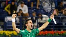 Djokovic in Dubai final saving three match points to beat France's Monfils