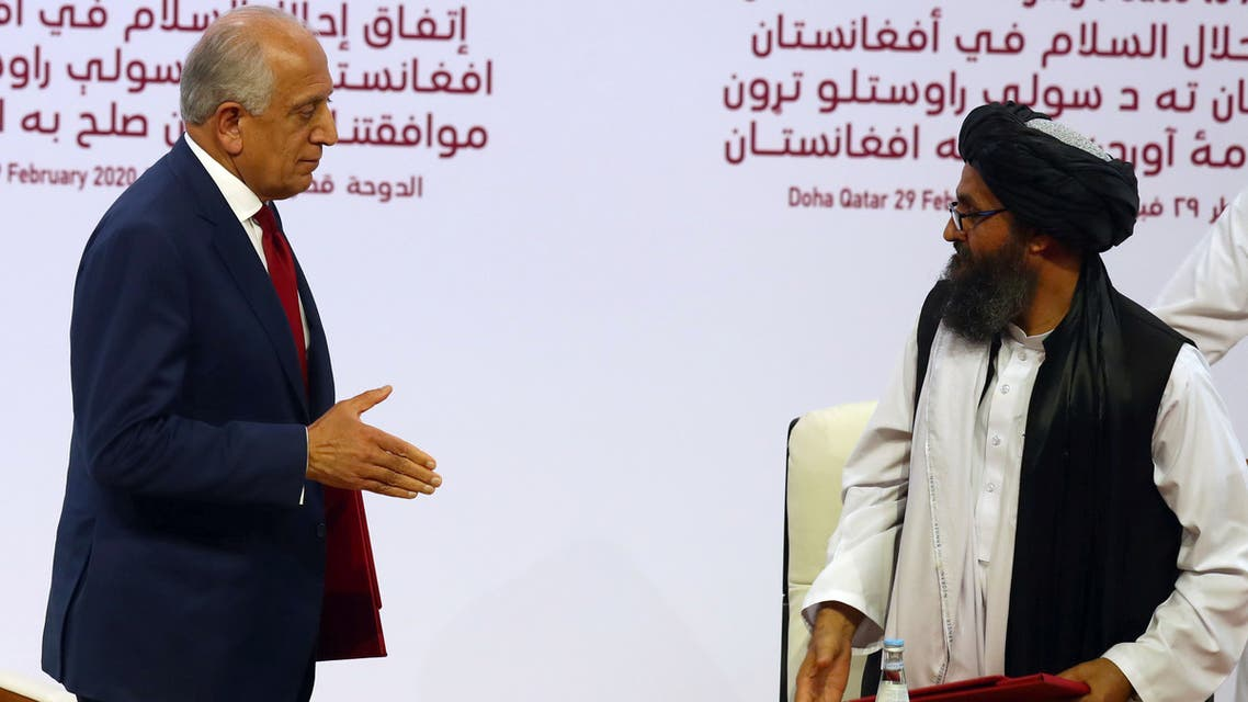 Mullah Abdul Ghani Baradar, the leader of the Taliban delegation, and Zalmay Khalilzad, U.S. envoy for peace in Afghanistan, are seen after signing an agreement at a signing ceremony between members of Afghanistan's Taliban and the U.S. in Doha, Qatar February 29, 2020. REUTERS/Ibraheem al Omari