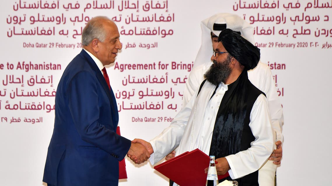 (L to R) US Special Representative for Afghanistan Reconciliation Zalmay Khalilzad and Taliban co-founder Mullah Abdul Ghani Baradar sign a peace agreement during a ceremony in the Qatari capital Doha on February 29, 2020 The United States signed a landmark deal with the Taliban, laying out a timetable for a full troop withdrawal from Afghanistan within 14 months as it seeks an exit from its longest-ever war.