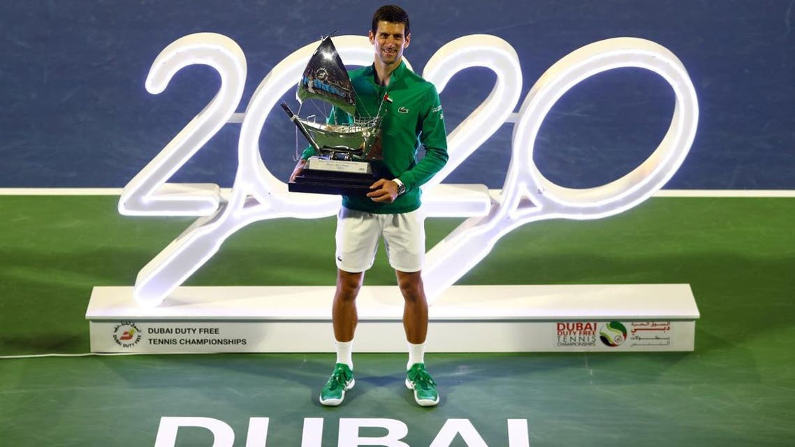 Serbia's Novak Djokovic poses with the trophy after winning the final against Greece's Stefanos Tsitsipas at the Dubai Duty Free Tennis Stadium on February 29, 2020. (Reuters)