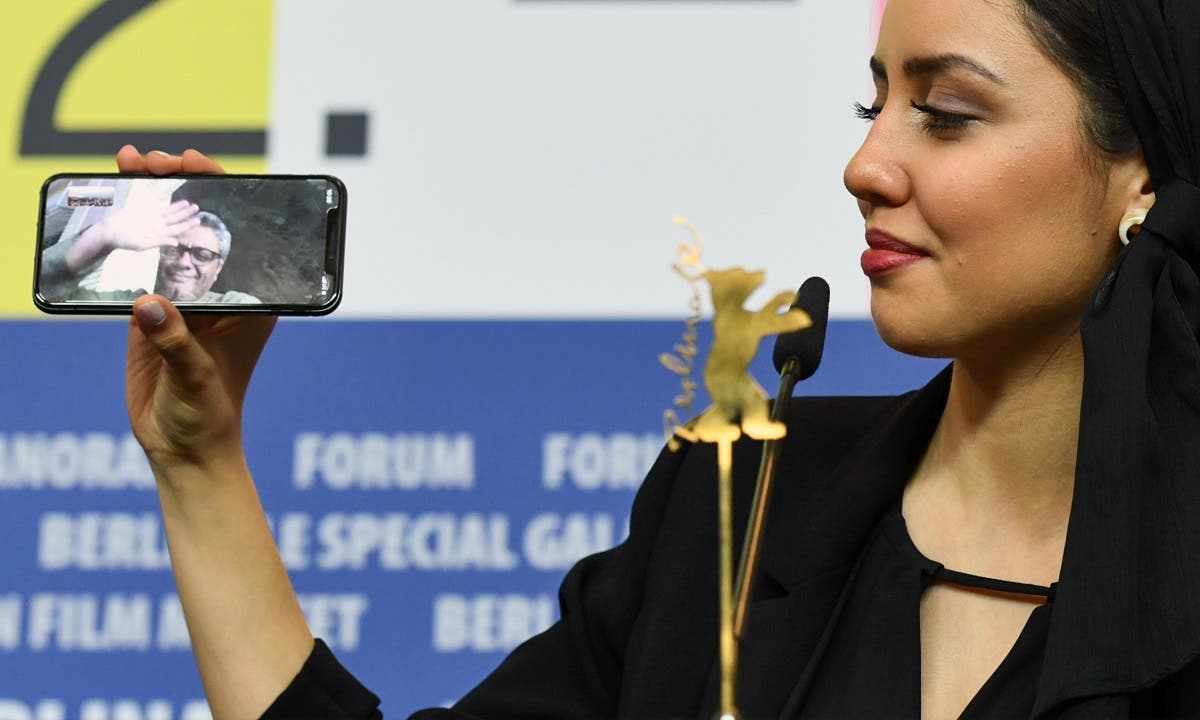 Director Mohammad Rasoulof, winner of the Golden Bear for Best Film for 'There Is No Evil', speaks through a video call as his daughter Baran Rasoulof holds a cellphone, during a news conference after the award ceremony. (Reuters)