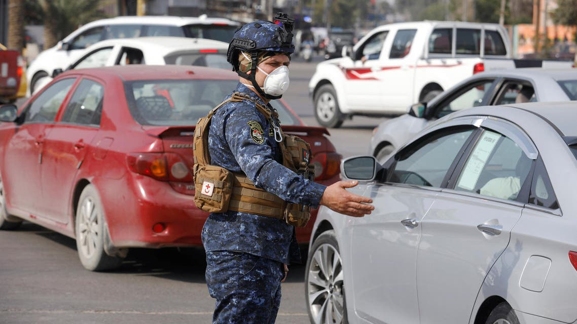 A member of the Iraqi security forces wears a protective face mask, following the coronavirus outbreak, in Baghdad, Iraq, February 29, 2020. (Reuters)