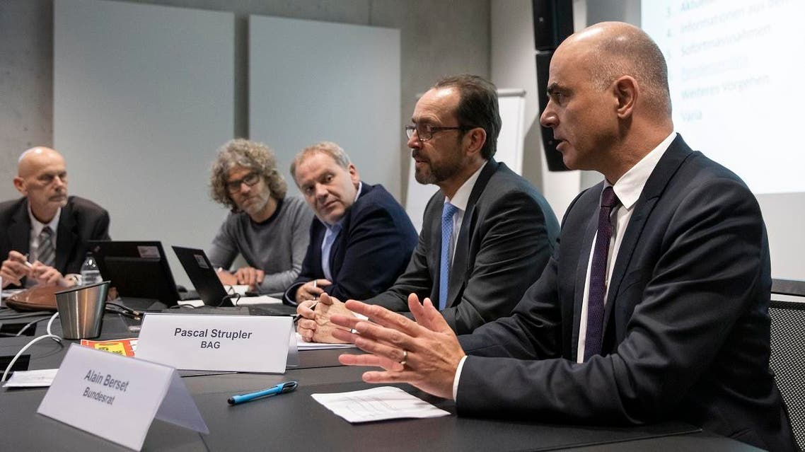 Swiss Federal Councillor and Health Minister Alain Berset, front, speaks at a meeting of the taskforce of the Federal Office of Public Health on the prevention of the further spread of the coronavirus COVID-19, on February 28, 2020 in Bern. (AFP)