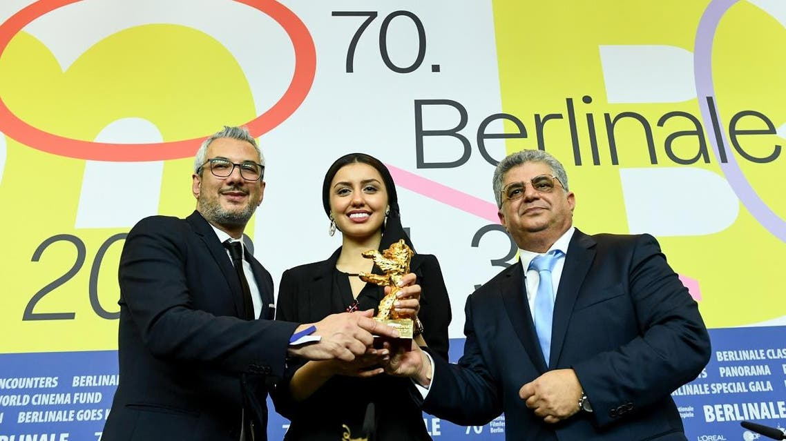 """Kaveh Farnam, Farzad Pak Baran Rasoulof, winners of the Golden Bear for Best Film for """"There Is No Evil"""", pose during a news conference after the award ceremony of the 70th Berlinale International Film Festival in Berlin, Germany, on February 29, 2020. (Reuters)"""