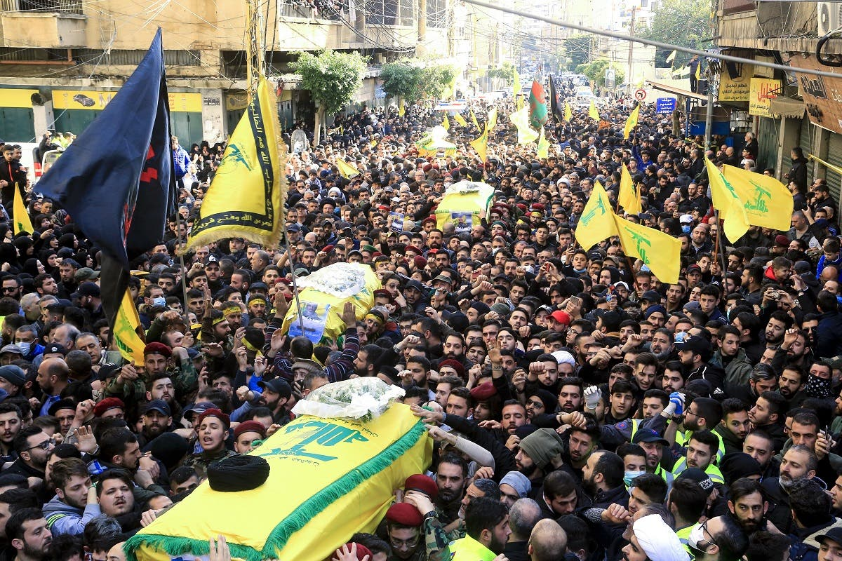 Supporters of Lebanon's Hezbollah carry the coffins during a funeral procession in a suburb of the Lebanese capital Beirut, on March 1, 2020. (AFP)