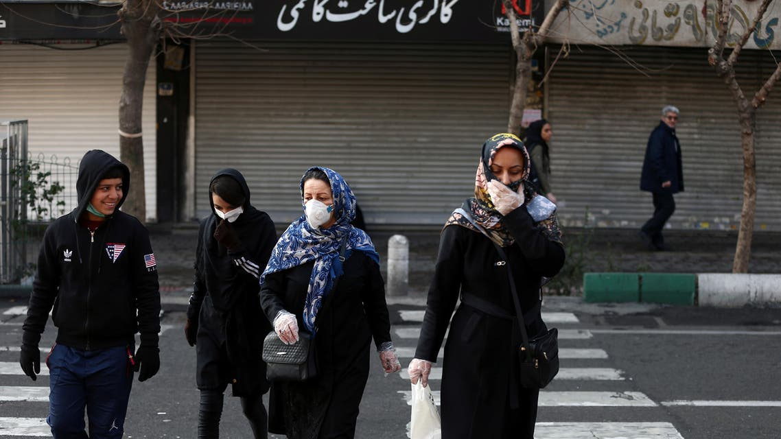 Iranian people wear protective masks to prevent contracting a coronavirus, in Tehran, Iran, February 29, 2020. (Reuters)
