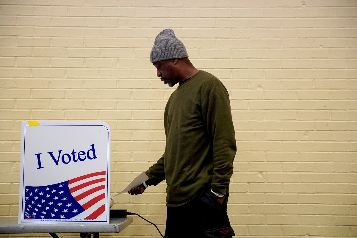 A man votes at a polling station in South Carolina's Democratic presidential primary in Columbia, South Carolina, US, February 29, 2020. (Reuters)
