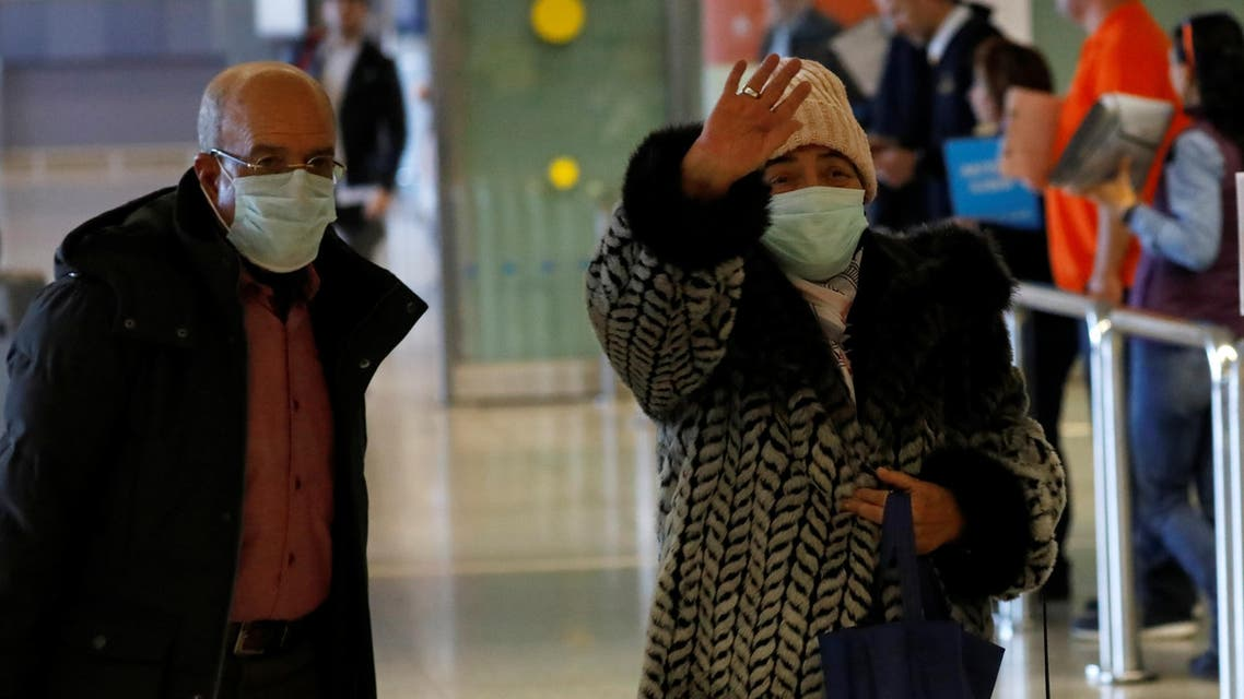 Tourists from Morocco wear masks to prevent contracting coronavirus at the Malaga-Costa del Sol airport, in Malaga, southern Spain, January 29, 2020. (Reuters)