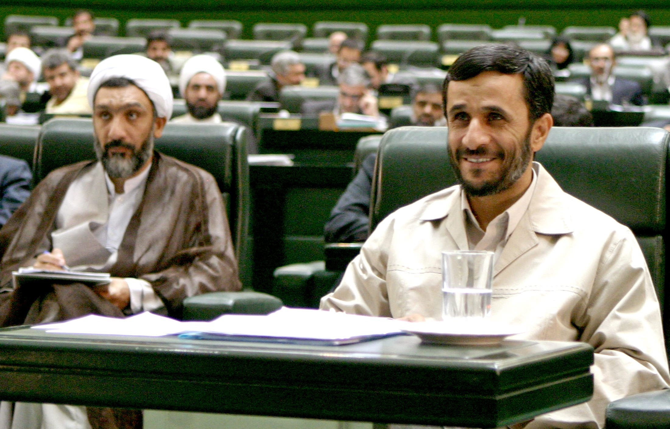 Mahmoud Ahmadinejad and the former Minister of Interior Mostafa Pourmohammadi. (File photo: Reuters)