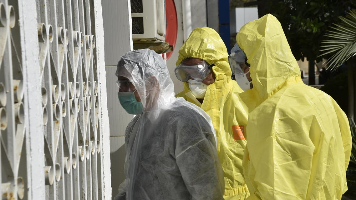 Algerian paramedics wearing protective outfits are pictured in front of El-Kettar hospital's special unit to treat cases of novel coronavirus in the capital Algiers on February 26, 2020. (AFP)