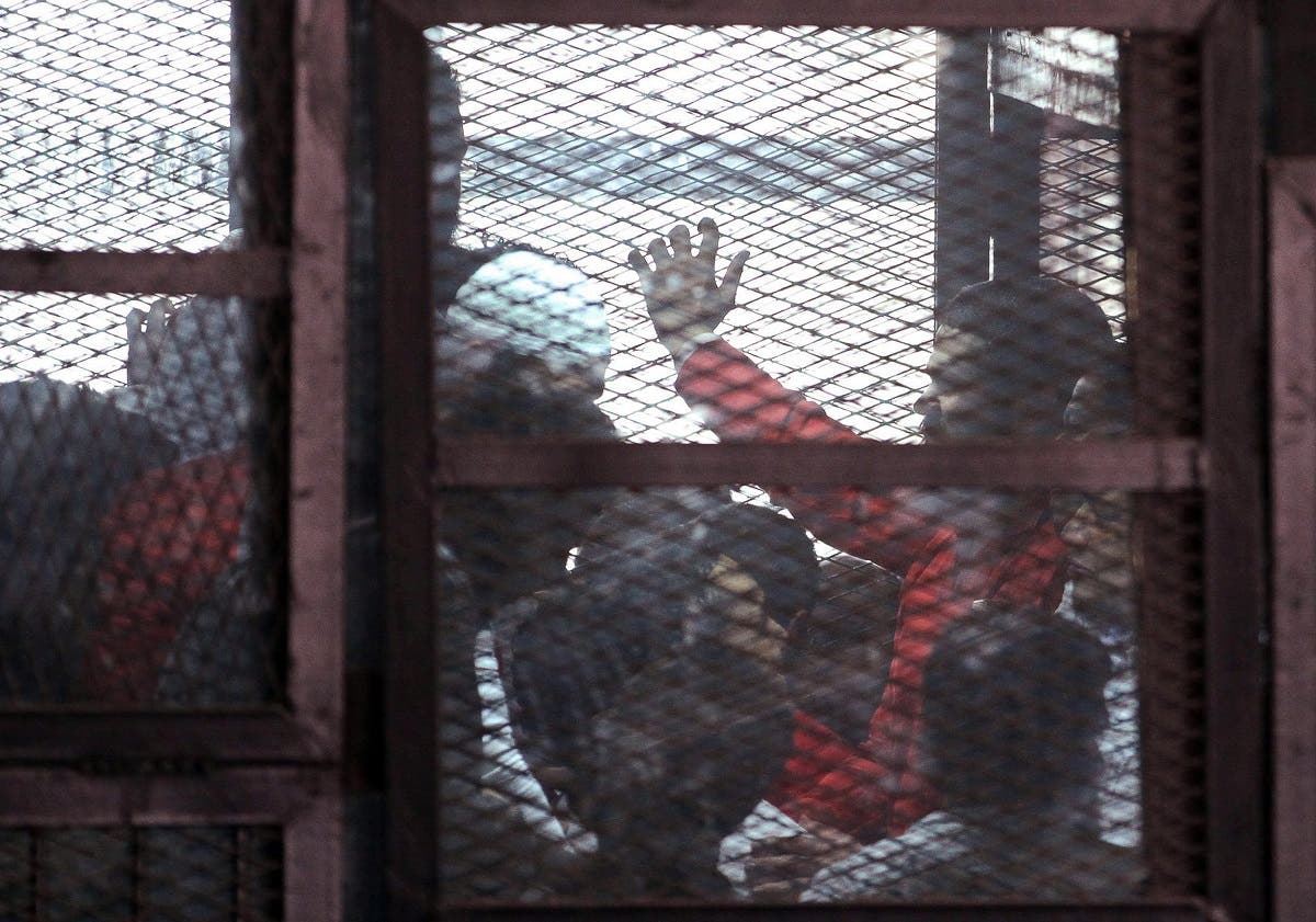 The accused are seen in a metal cage during a trial of 200 people charged with belonging to the Ansar Bait al-Maqdis group, in a court in Cairo March 5, 2015. (Reuters)