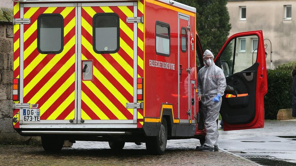 Members of emergency and intensive care services are at work after a person was allegedly contaminated by the new Covid-19 Coronavirus, on March 2, 2020 at Etienne Marie de la Hante retirement home in Crepy-en-Valois. (AFP)