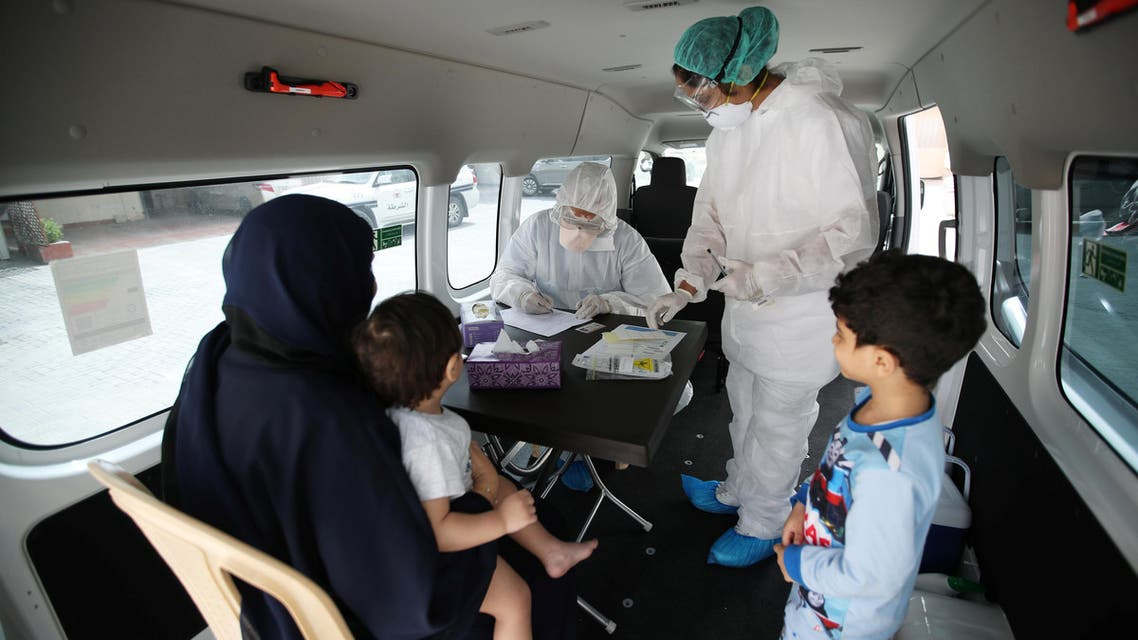 Doctors check a traveller in their designated residential area to check on residents who returned from Iran if anyone is infected with the coronavirus, at Isa Town Health Center, south of Manama, Bahrain, March 2, 2020. (Reuters)