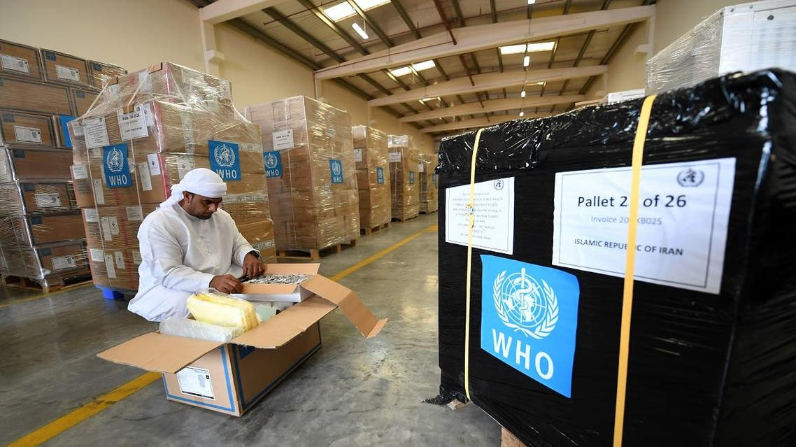 Officials check medical equipment and coronavirus testing kits provided by WHO at the al-Maktum International airport in Dubai on March 2, 2020. (AFP)