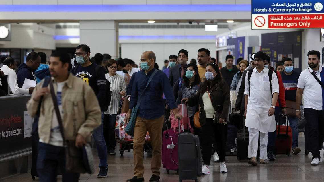 Travelers wear masks at the Dubai International Airport in the UAE, January 29, 2020. (File photo: Reuters)