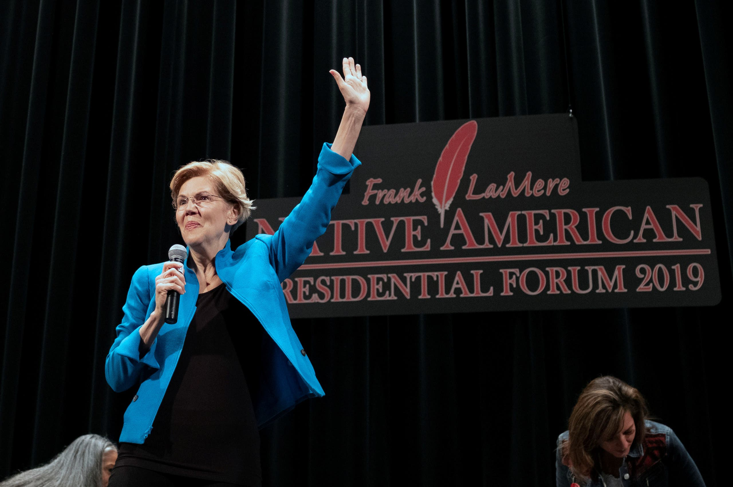 Democratic presidential candidate Elizabeth Warren waves as she arrives to the Frank LaMere Native American Forum in Iowa on August 19, 2019. (Reuters)