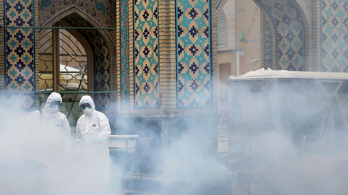 Members of the medical team spray disinfectant to sanitize outdoor place of Imam Reza's holy shrine, following the coronavirus outbreak, in Mashhad, Iran