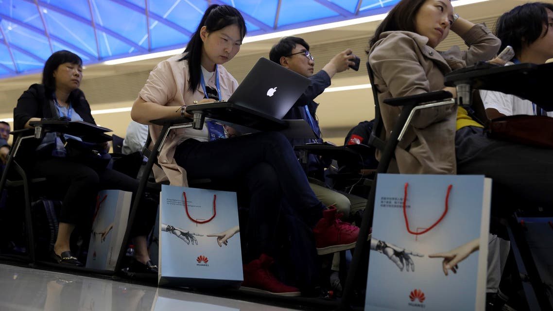 Journalists attend a Huawei event in Beijing on May 15, 2019. (AP)
