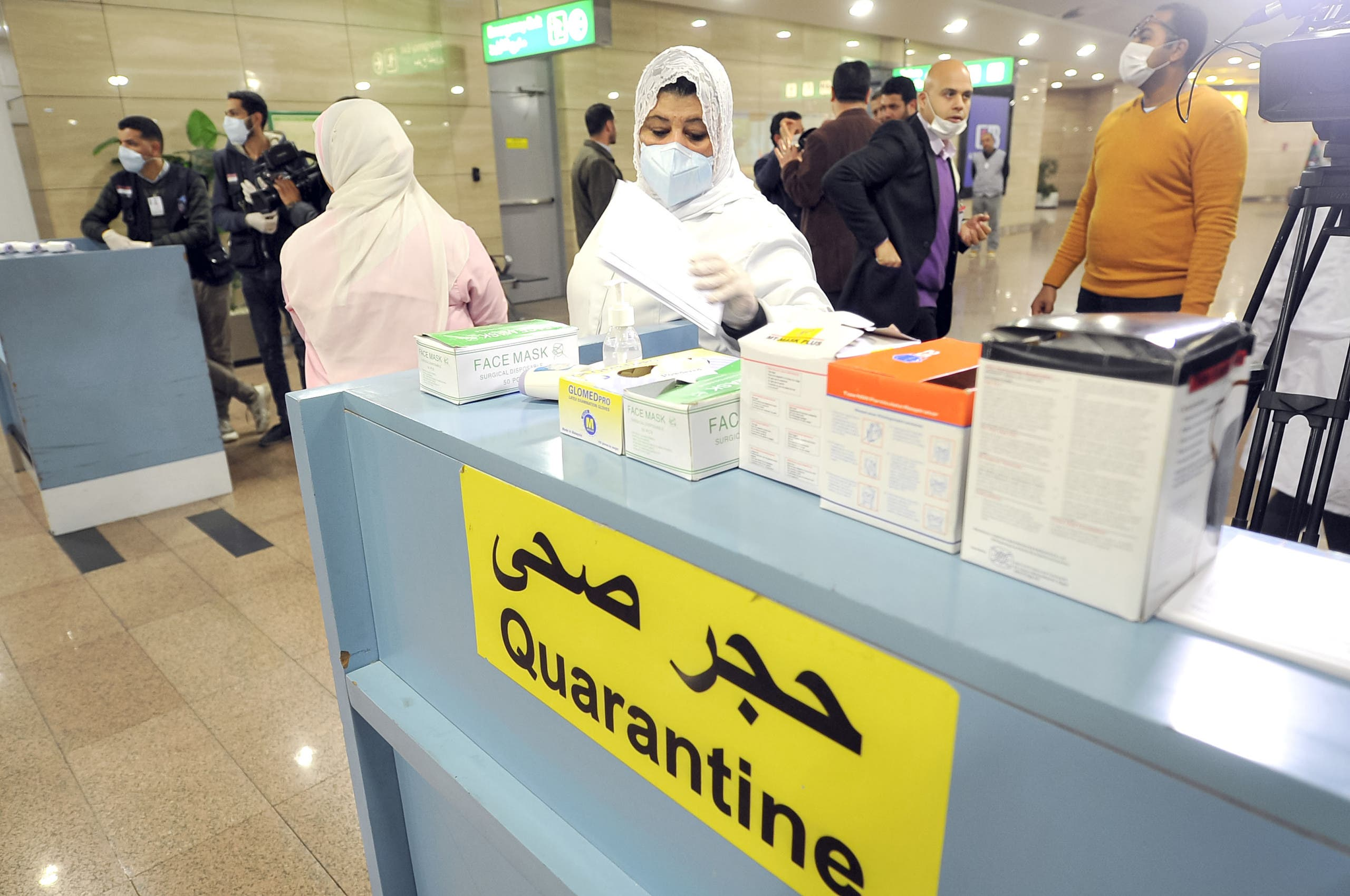 Egyptian Quarantine Authority employees prepare to scan body temperature for incoming travelers at Cairo International Airport to detect coronavirus. (File photo: AFP)