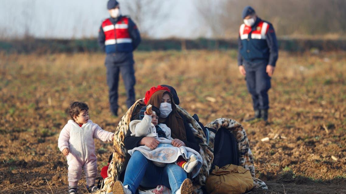 Migrants rest next to the Turkey's Pazarkule border crossing with Greece's Kastanies, near Edirne, Turkey, March 3, 2020. REUTERS/Leonhard Foeger