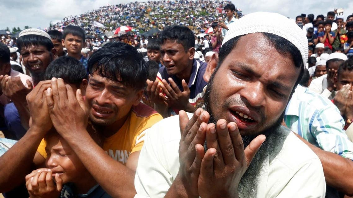 Rohingya refugees take part in a prayer as they gather to mark the second anniversary of the exodus at the Kutupalong camp in Cox's Bazar. (Reuters)