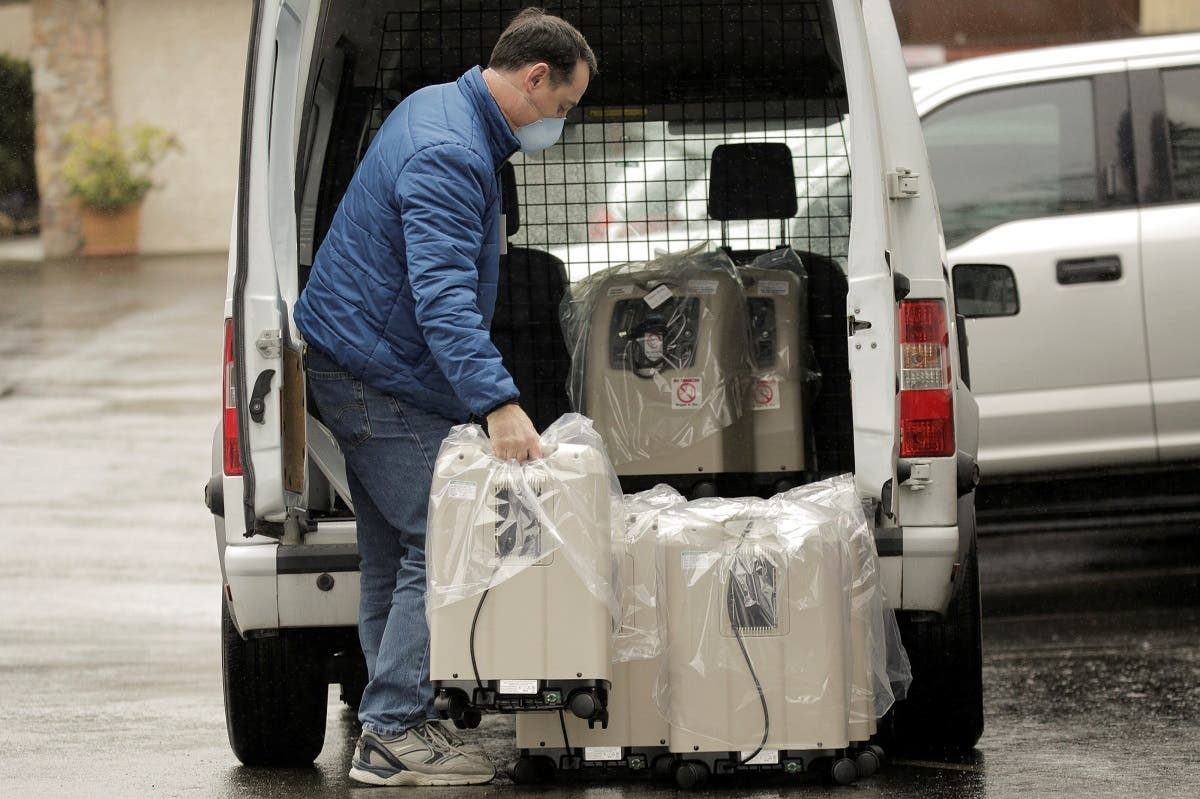 A driver delivers oxygen therapy devices at the Life Care Center of Kirkland, the long-term care facility linked to several confirmed coronavirus cases in the state, in Kirkland, Washington, US March 2, 2020. (Reuters)