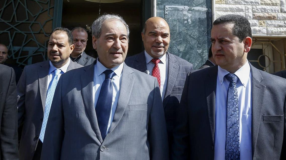 Syrian Deputy Foreign Minister Faisal Miqdad (front L) and Libya's parallel eastern government foreign minister Abdulhadi Lahweej (front R) and deputy Prime Minister Abdul Rahman Al-Ahiresh (back R), leave the Libyan Embassy in Damascus after reopening it on March 3, 2020. (AFP)