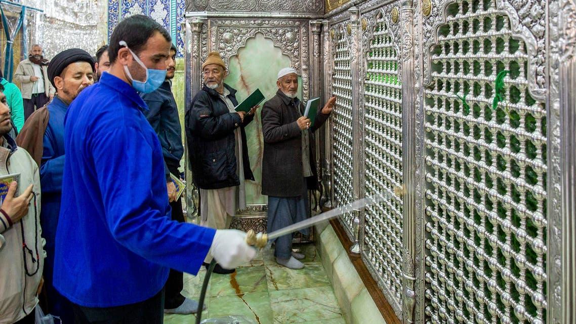 A a man disinfects the shrine of Saint Masoumeh against coronavirus in the city of Qom, Iran. (AP)