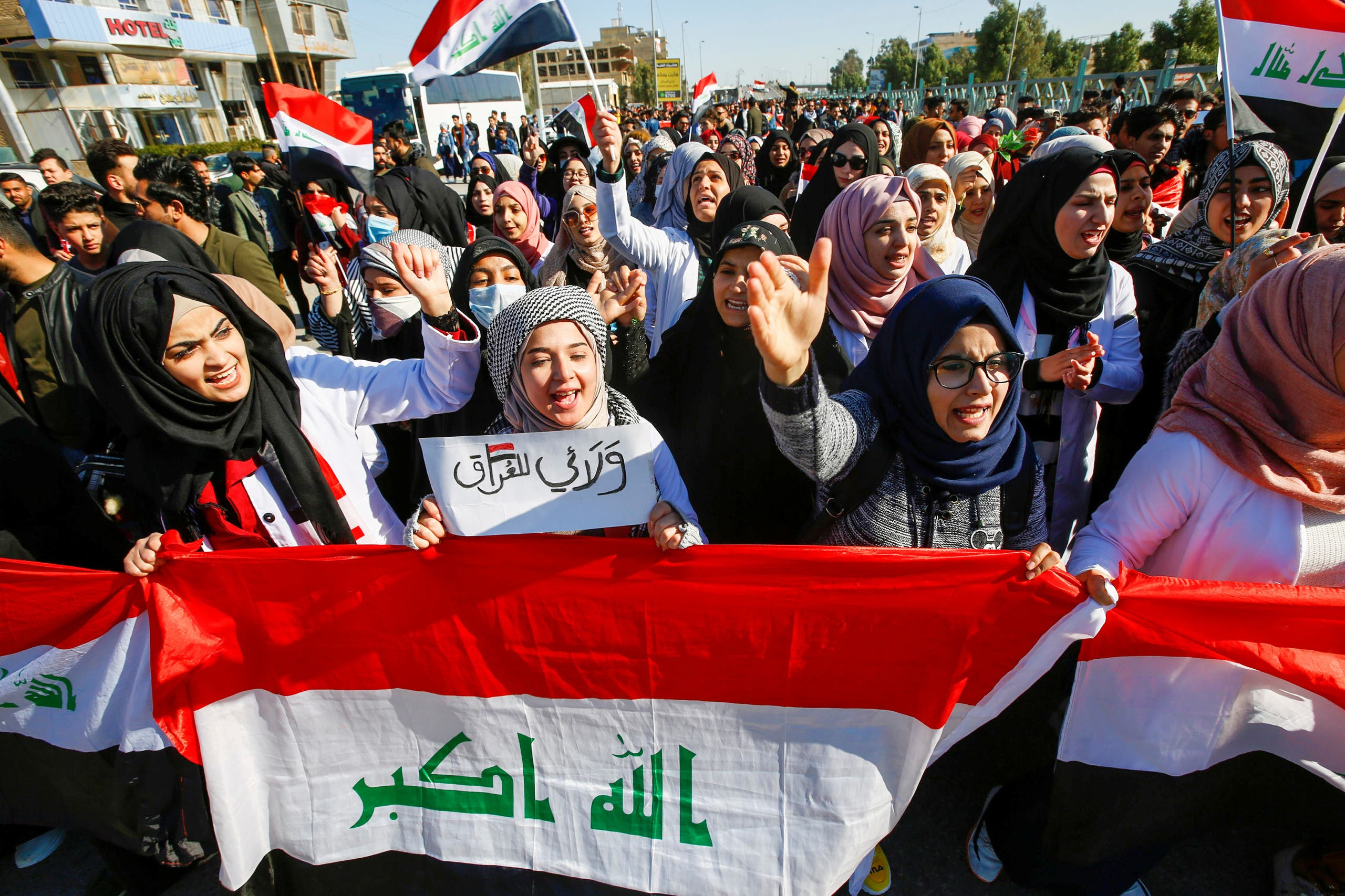 University students shout slogans during ongoing anti-government protests in Najaf, Iraq, on January 12, 2020. (Reuters)