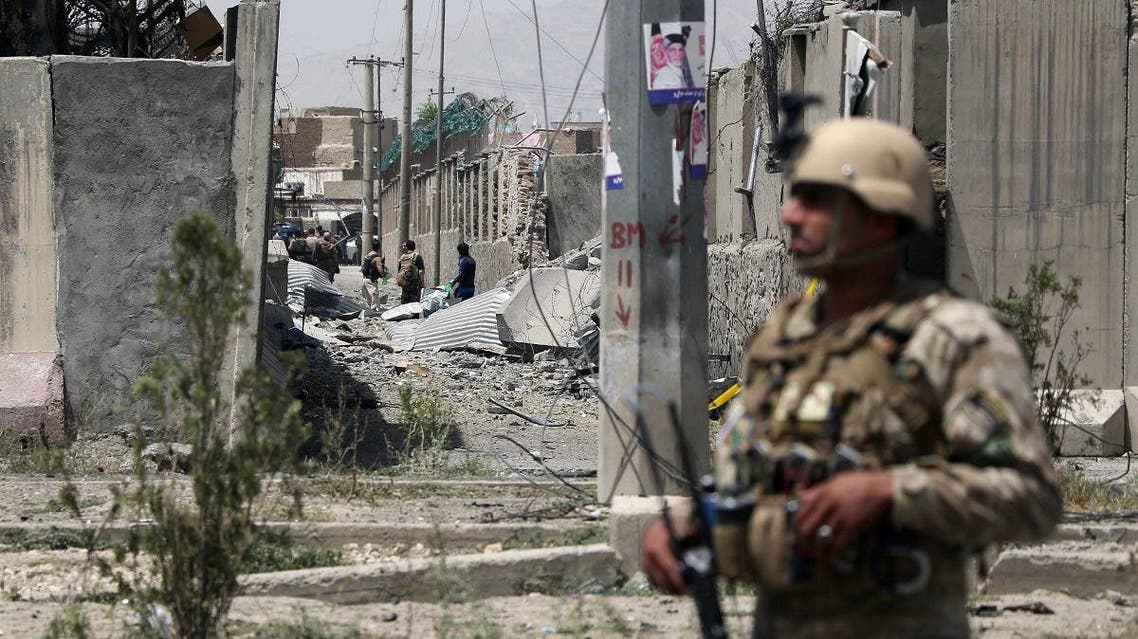 An Afghan security personnel stands guard at the site where a Taliban car bomb detonated at the entrance of a police station in Kabul on August 7, 2019. (File photo: AFP)