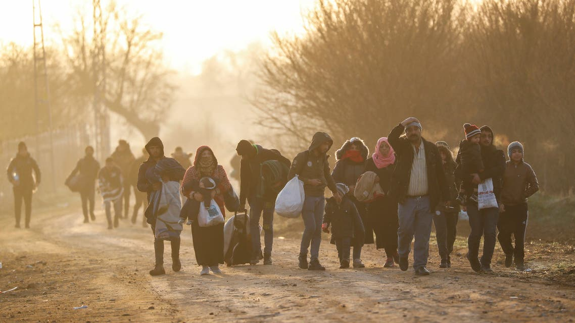 Migrants walk next to the Turkey's Pazarkule border crossing with Greece's Kastanies, near Edirne, Turkey, March 3, 2020. REUTERS/Leonhard Foeger