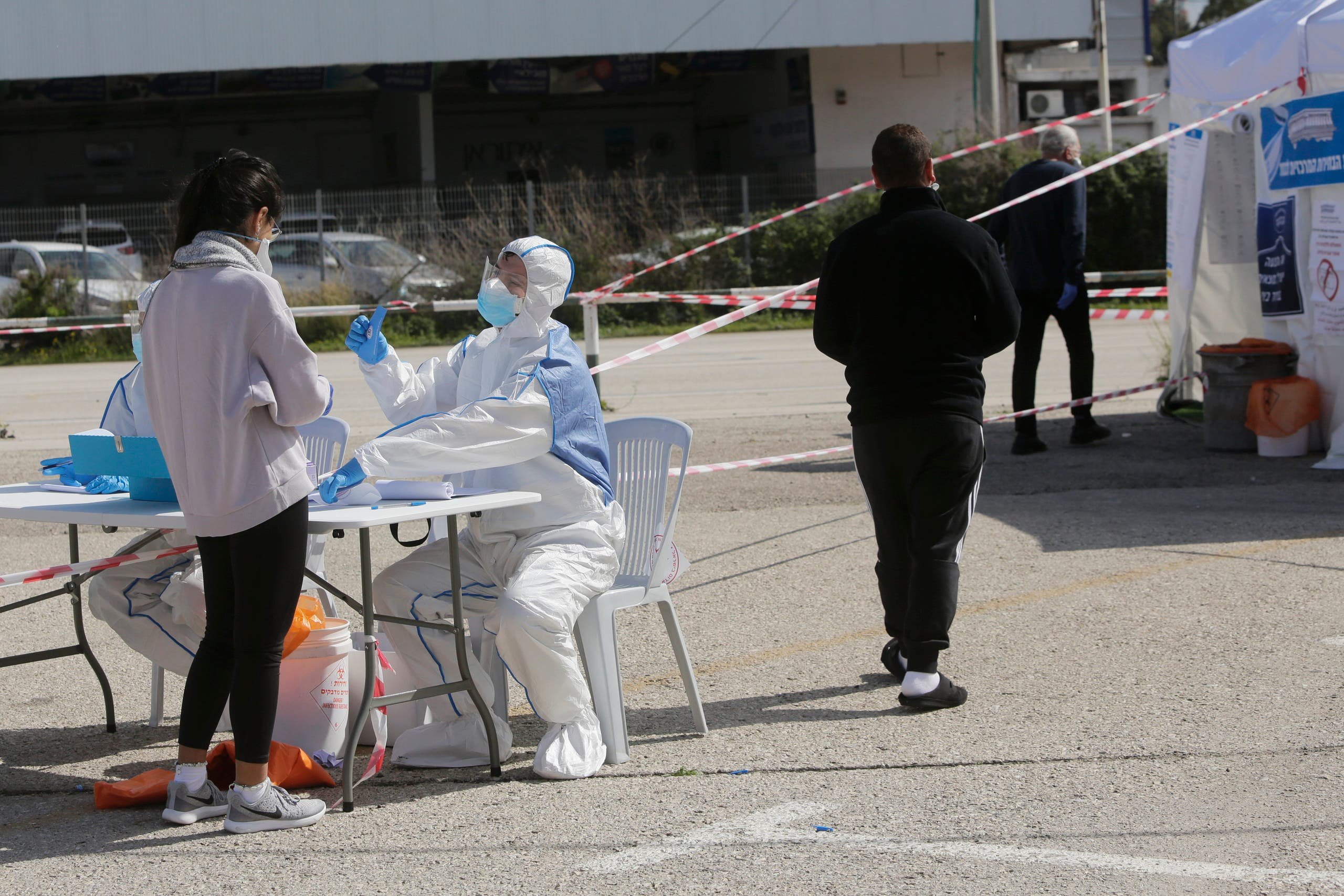People quarantined with Corona virus arrive to vote in Haifa, Israel, March 2, 2020 (AP)