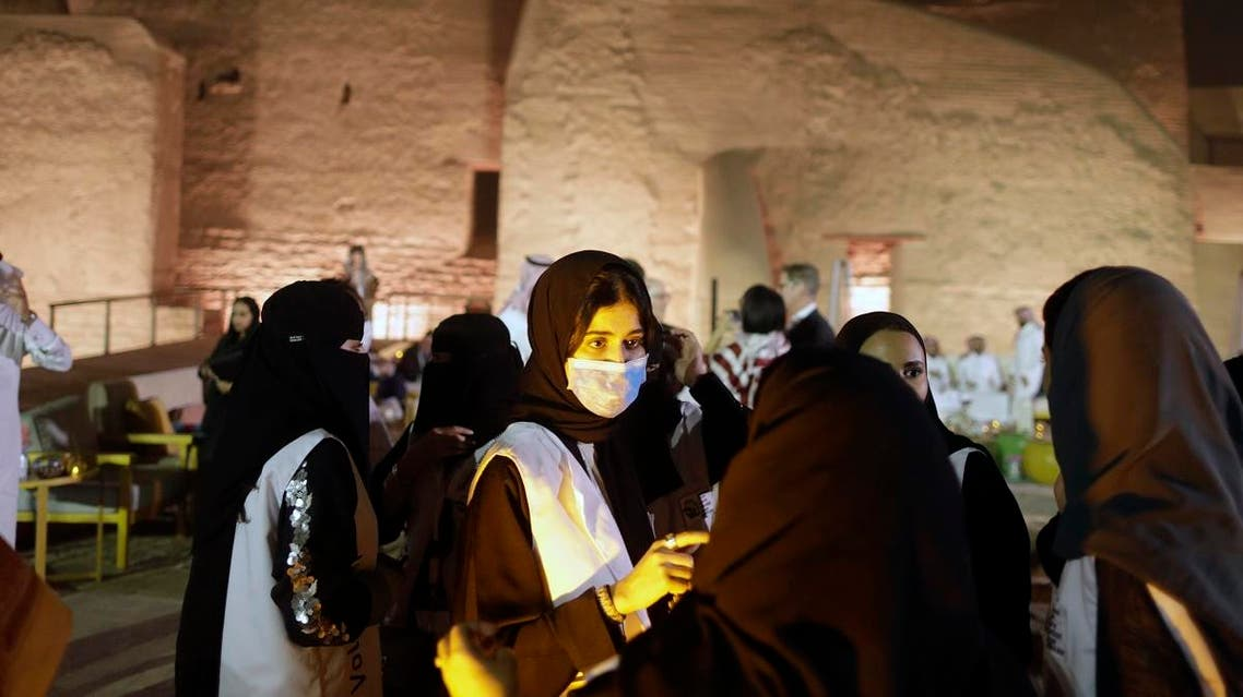 A Saudi tour guide wears a mask, due to the coronavirus, in front of the historical Salwa Palace, originally the home of the country's first founders, in Diriyah, outside Riyadh, Saudi Arabia, Tuesday, Feb. 25, 2020. (AP)