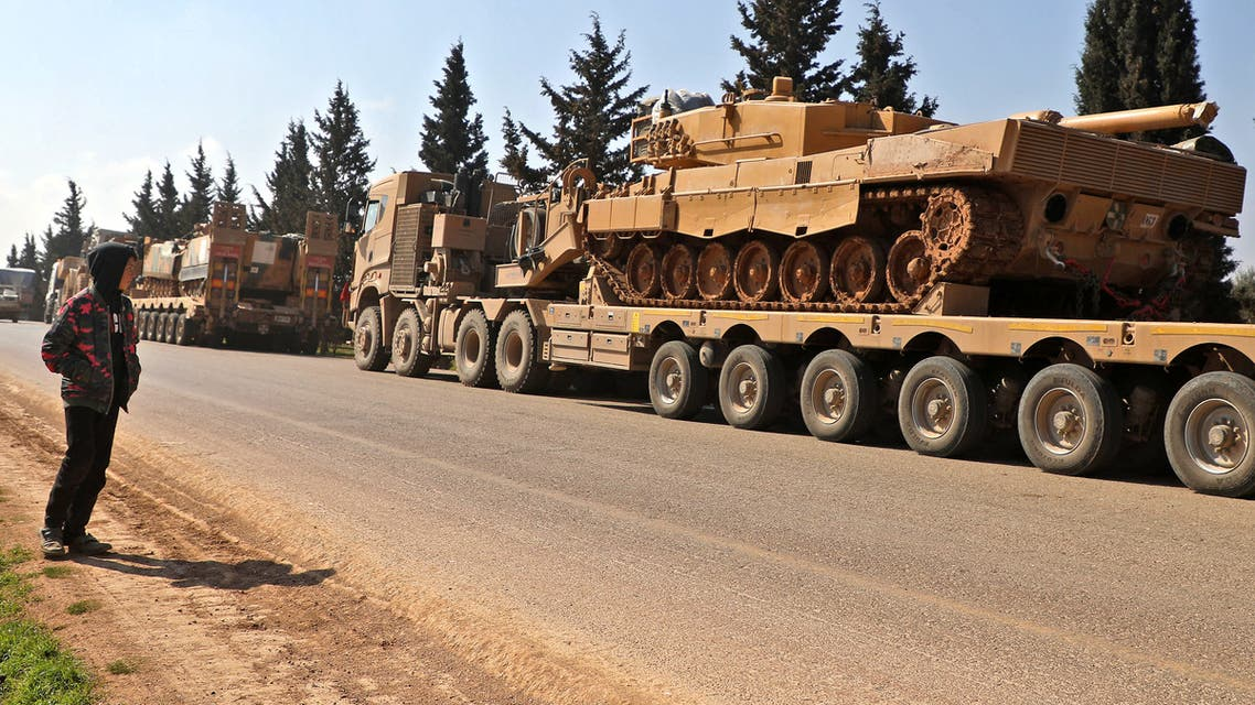 A convoy of Turkish military vehicles is pictured near the town of Hazano in the rebel-held northern countryside of Syria's Idlib province on March 3, 2020. A Turkish fighter jet downed a Syrian regime warplane over northwestern Syria and the pilot was killed, a war monitor said, in the third such downing in three days. Regime artillery fire, meanwhile, killed nine civilians in the main city in the embattled opposition bastion of Idlib. Regime forces have since December been battling to retake the jihadist-dominated stronghold, where Ankara backs some rebel groups.