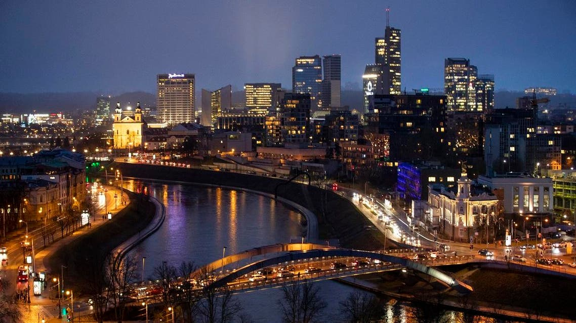The King Mindaugas bridge crosses the river Neris and buildings of the commercial district are seen during a warm winter evening in Vilnius, Lithuania. (File photo: AP)