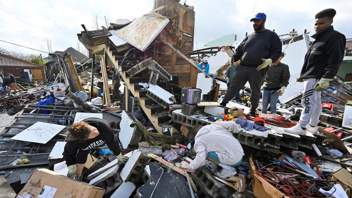 People try to salvage merchandise at Music City Vintage after a tornado hit eastern Nashville, Tennessee, US, on March 3, 2020. (Reuters)