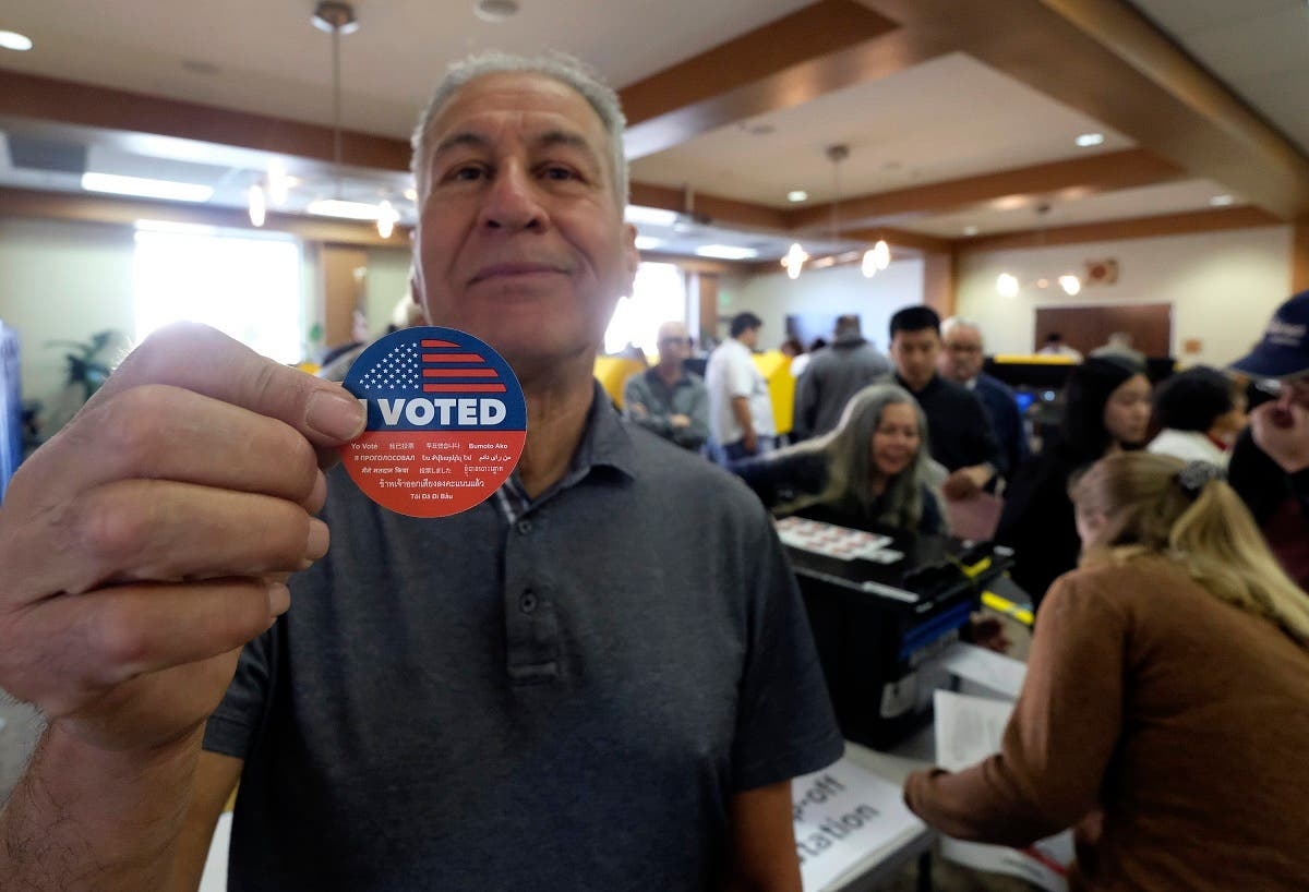 "Frank Salazar, 70, shows an ""I voted"" sticker after casting his ballot on the Super Tuesday, at a voting center in Alhambra, California on March 3, 2020. (AP)"