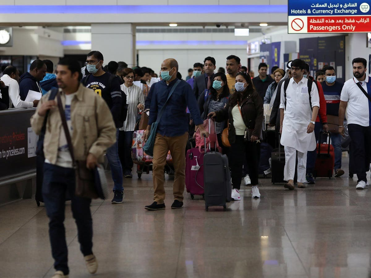 Travelers wear masks as they arrive at the Dubai International Airport, United Arab Emirates, on January 29, 2020. (Reuters)
