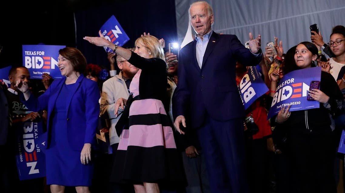 Democratic presidential candidate former Vice President Joe Biden, right, is joined by former rival Sen. Amy Klobuchar, left, during a campaign stop in Dallas, on March 2, 2020. At center is Jill Biden. (AP)