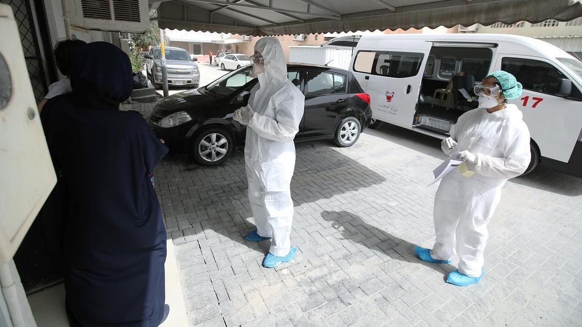 Doctors call a traveler who returned from Iran at their residency, to check if is infected with the novel coronavirus, at Isa Town Health Center, south of Manama. (Reuters)