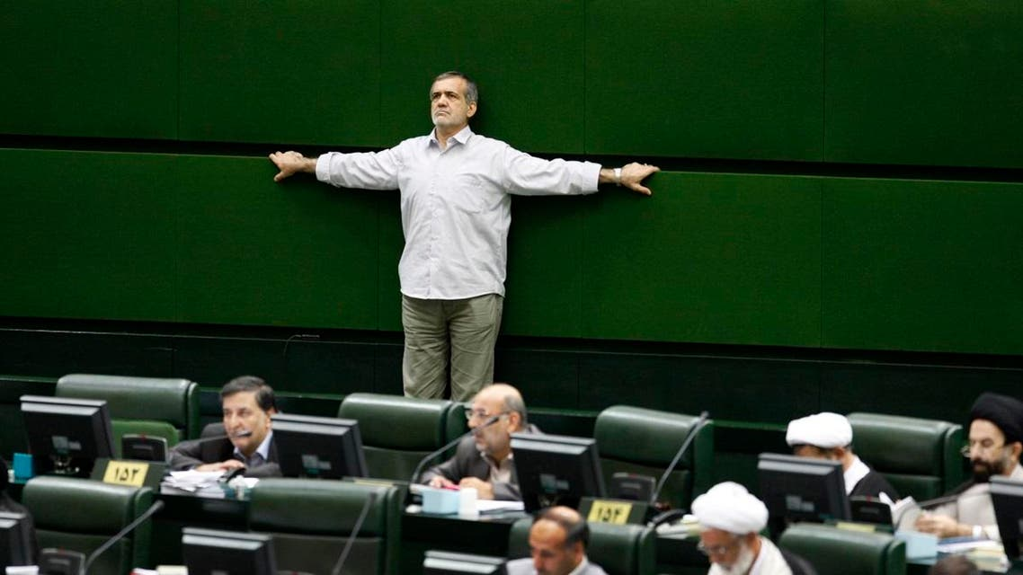 Iranian lawmaker, Masoud Pezeshkian, stretches his arms as he attends in an open session of parliament in 2009. (File photo: AP)