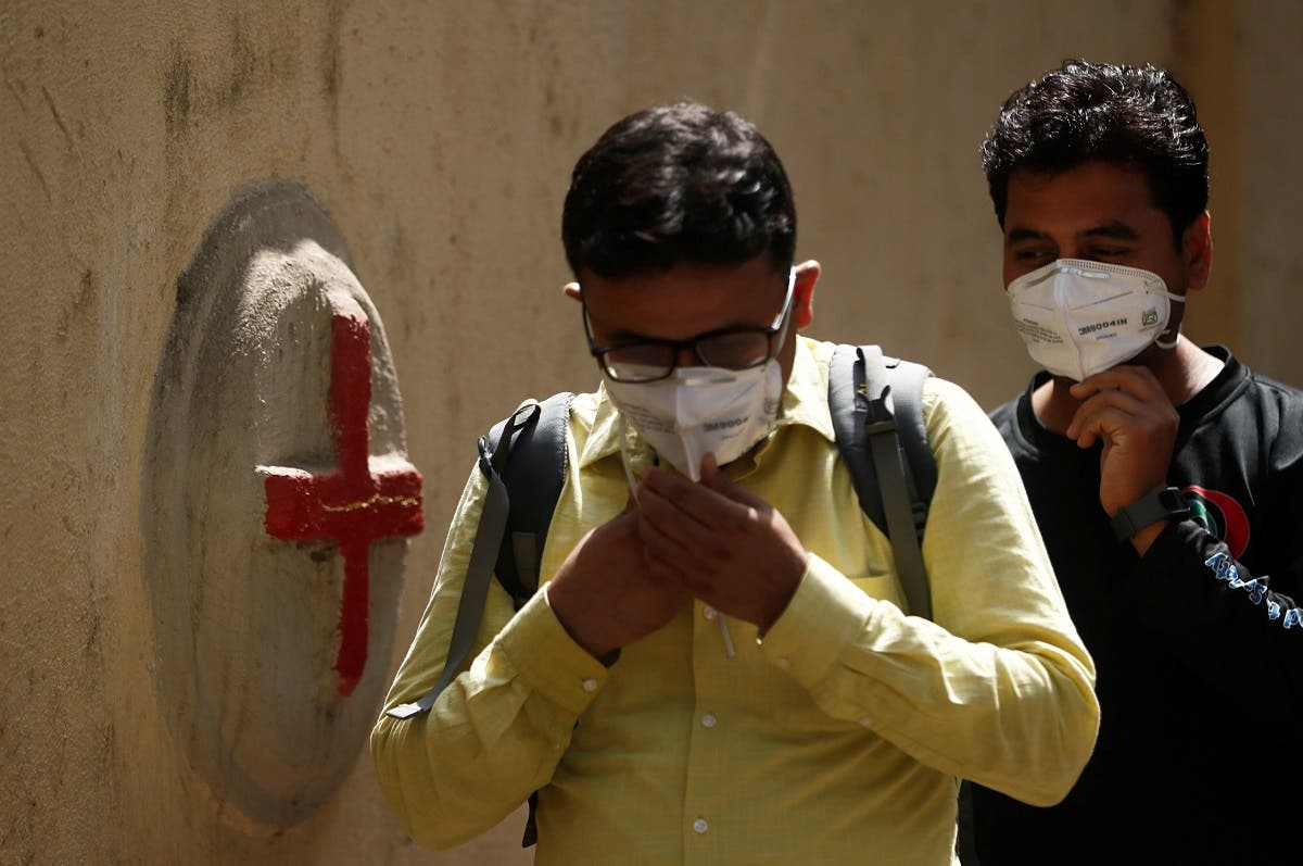 Men enter a hospital where a special ward has been set up for the coronavirus disease in Mumbai. (Reuters)